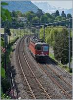 The SBB Re 6/6 11689 (Re 620 089-3)  Gerra Gambarogno  on the way to Lausanne near Villenvueve.