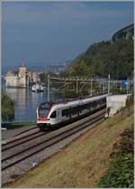 A SBB RABe 523 Flirt on the way to Allaman by the Castle of Chillon.