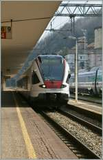 TILO Flirt to Castione Arbedo is arriving at Como San Giovanni Station.