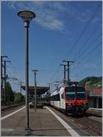 A SBB Domini on the way to Biel/Bienne by his stop in Twann.