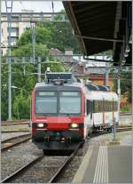 A SBB  Domino  is arriving in La Chaux de Fonds.