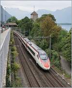 A SBB ETR 610 from Milan to Geneva by the Castle of Chillon.