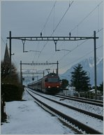 A SBB Re 460 wiht an IR to Geneve Aeroport by Villette VD.