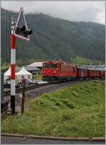 The MGB Gm 4/4 with a DFB Special Service is leaving Oberwald.