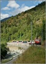 The Glacier Express 902 from Zermatt to Davos near Betten Talstation.