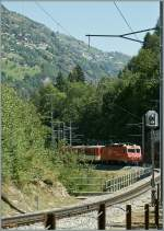 MGB HGe 4/4 wiht an Train to Zermatt is approching the St Niklaus Area.