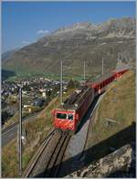 The MGB HGe 4/4 II N° 108 with his local train over Andermatt.