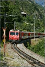The MGB  Mattherhorn Gotthard Bahn  HGe 4/4 is on the way to Brig. Pictured by Stalden, the 22. 07.2012