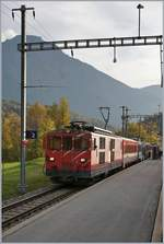 A MGB De 4/4 wiht a local Service in Bitsch.