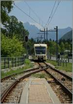 A FART Centovalli Express is arriving at Druogno Station.