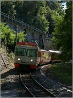 A FLP local train is arriving at Sorengo Laghetto.