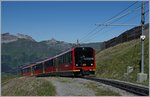 A new Jungfraubahn train, the Bhe 4/8 223 by the Eigergletscher Station.