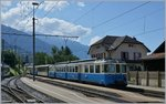 The MOB ABDe 8/8 4002  VAUD  with a local train to Montreux in Chernex.