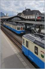 The MOBABDe 8/8 4002 VAUD and 4004 FRIBOURG in Montreux.