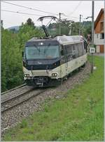 The MOB Ge 4/4 8004 with a MOB Panoramic Service from Zweisimmen to Montreux by Plancahmp.