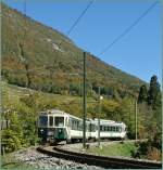 The LEB Bt and Be 4/4 is engaged in an ASD Local train service here by over Aigle in the vineyards.