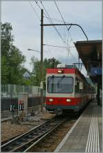 A WB local train is leaving Liestal.
