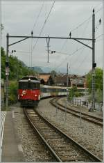 The  zb  (Zentralbahn) De 110 001-3 with his GoldenPass-Service is arriving at Brienz.