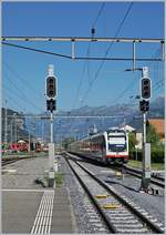 A zbIR  Luzern Engelberg-Interlaken Express  is arriving at Meiringen.