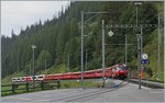 The RhB Fast train 1149 from Chur to St Moritz with Glacier Express 902 Part from Zermatt is arriving at Bergün Bravuogn.