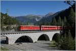 The Ge 6/6 II 707  Scuol  with an RhB Fast Train Service to St Morizt between Bergün and Preda.