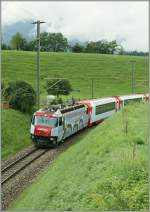 Ge 4/4 III with the Glacier Express between Bonaduz and Reichenau. 
