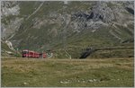 A Bernina local train between Bernina Lagalp and Ospizio.