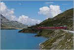 A RhB Bernina local train by the Lago Bianco (Withe Lake) between Bernina Ospizio and Alp Grüm.
