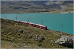 A RhB Bernina local train by the Lago Bianco (Withe Lake) near Bernina Ospizio.