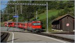 The red RhB Ge 4/4 III 648 wiht a local train to Davos is leaving Filisur. 