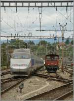 TGV Lyria and Ee 3/3 in Lausanne.