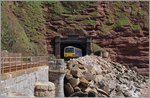 The Great Western Railway Class 143 618 is comming out of the 521 yd 476 m long Parson's Tunnel between Dawlish and Teignmouth.