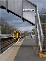 The ScotRail Class 158 (158 735) is arriving at Dalmeny.