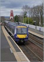 The Scotrail 170 454 in Dalmeny; in the background the Forth Bridge.