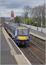 The ScotRail 170 454 in Dalmey, in the Background the Forth Bridge.