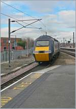 A GNER Class 43 HST 125 is leaving York.