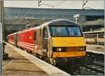 Virgin Class 90 002 in London Euston waits on the departure.