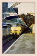The 90 033 with the Scot-Rail Sleeper Service  The Caledonian Slepes   in Edinburgh Waverley. 