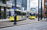 Manchester Metrolink Trams 3024 and 3096 (Bombardier M 5000) crossing Portland Street near the station Piccadilly Gardens.