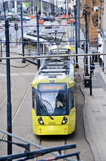 Tram 3042 (Bombardier M5000) from Manchester Metrolink. The Picture is taken from the Pedestrian Bridge over London Road.