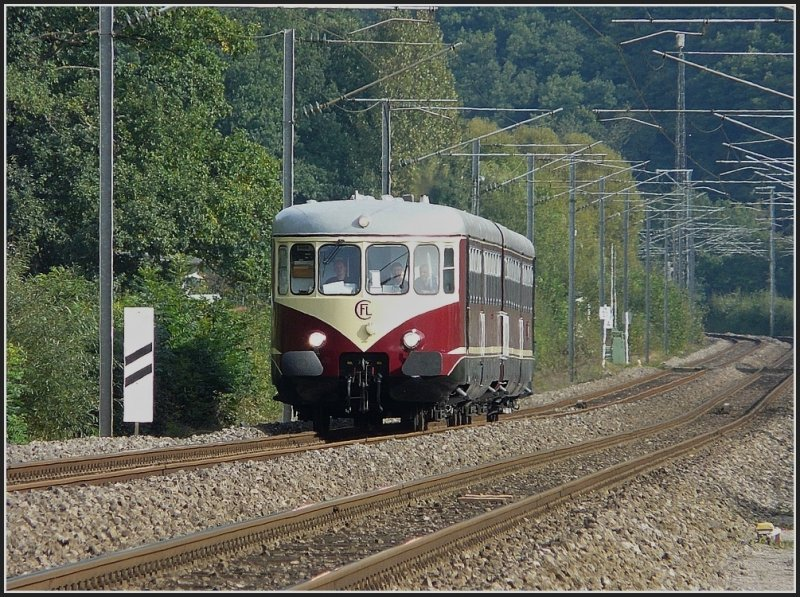 Westwaggon 208/218 running near Erpeldange/Ettelbrück on its way from Troisvierges to Luxembourg City on September 21st, 2009.